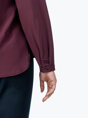 Women's Burgundy Patch Pocket Blouse on Model in Close-up of Her Shirt Cuff