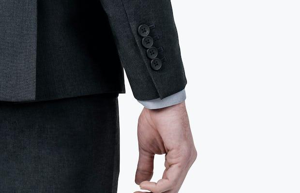 Men's Dark Charcoal Velocity Suit Jacket on Model Facing backward in closeup of cuff