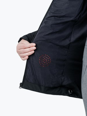 Women's Black Mercury Intelligent Heated Jacket on Model in Close-up of Pocket Heating Element