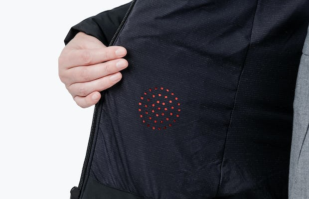 Women's Black Mercury Intelligent Heated Jacket on Model in Close-up of Pocket Heating Element