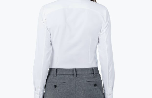 Women's White Aero Zero Dress Shirt on Model Facing Back