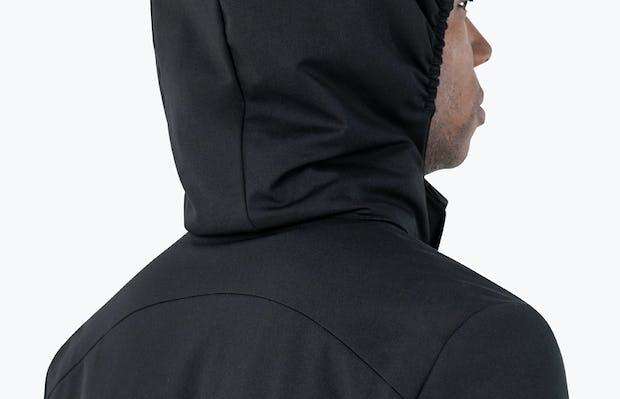 Men's Kinetic Town Coat - close shot facing away and wearing hood