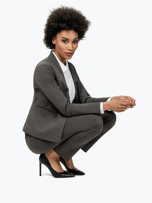 Women's Charcoal Heather Kinetic Blazer on Model Crouching on the Ground