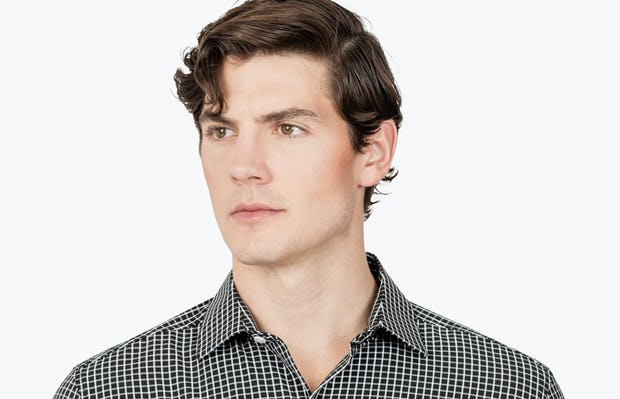 Men's Black Grid Aero Zero Dress shirt headshot of model looking to the right