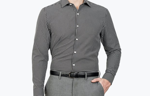 Men's Black Grid Aero Zero Dress shirt model facing forward with hand in pocket