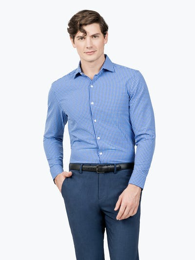 Men's Blue Grid Aero Zero Dress shirt model facing forward with hand in pocket