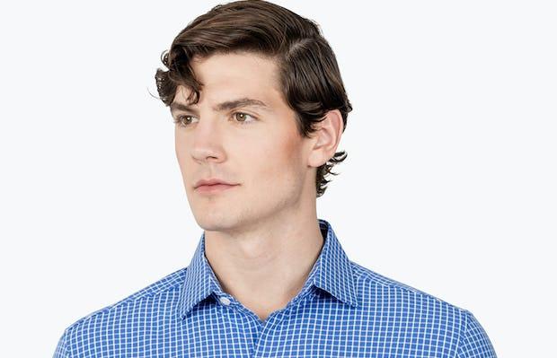 Men's Blue Grid Aero Zero Dress shirt headshot of model looking to the right