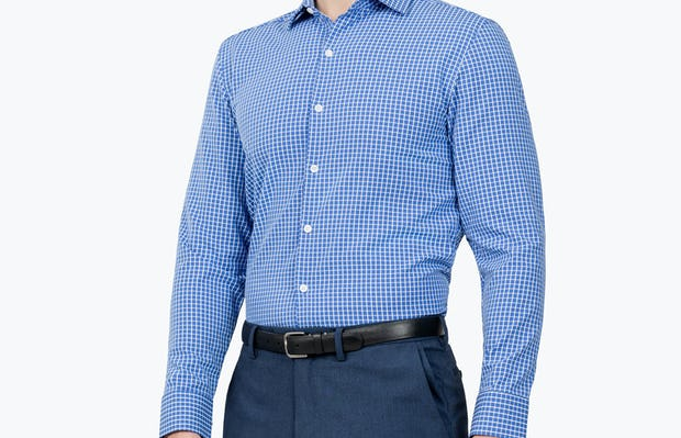 Men's Blue Grid Aero Zero Dress shirt model facing forward and to the right