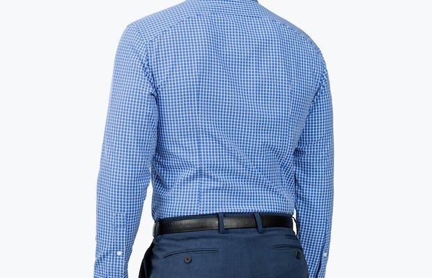 Men's Blue Grid Aero Zero Dress shirt model facing backward and to the left