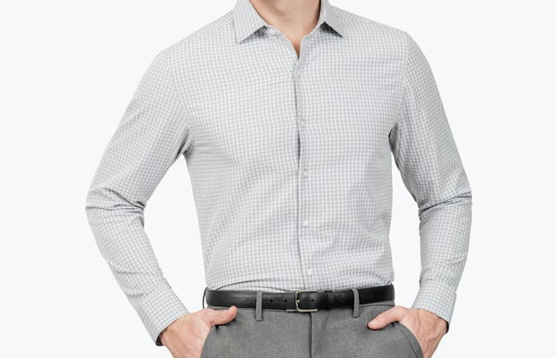 Men's Grey Grid Aero Zero Dress shirt model facing forward with hands in pockets
