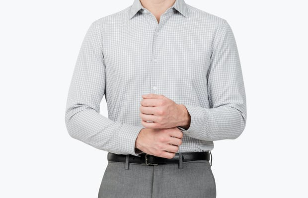 Men's Grey Grid Aero Zero Dress shirt model facing forward adjusting cuff