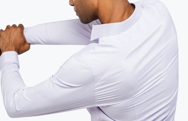 Men's Lavender Grid Aero Dress Shirt on Model Facing Backward with Arm Stretched Across Chest