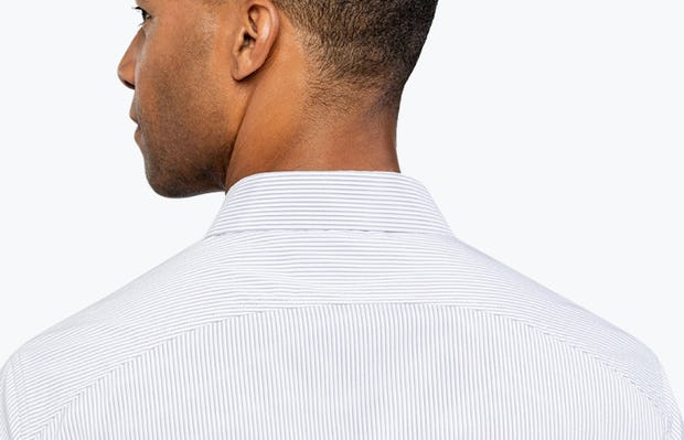 Men's Lavender Shadow Stripe Aero Dress Shirt on Model Facing Backward in Close-Up of Curved Back Yoke