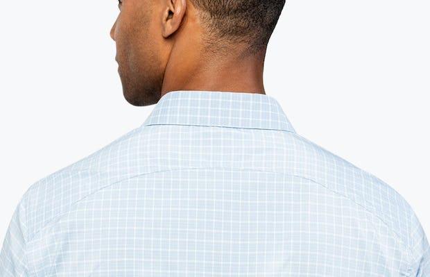 Men's Blue Plaid Aero Dress Shirt on Model Facing Backward in Close-Up of Curved Back Yoke
