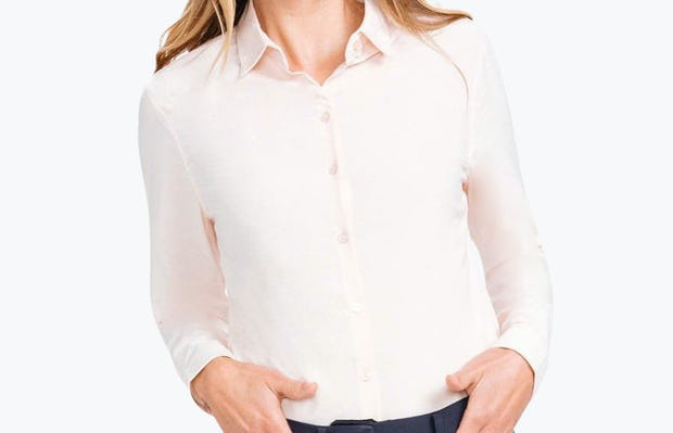 Women's Blush Easier than Silk Shirt on Model Facing Backward with Hands in Pant Pockets