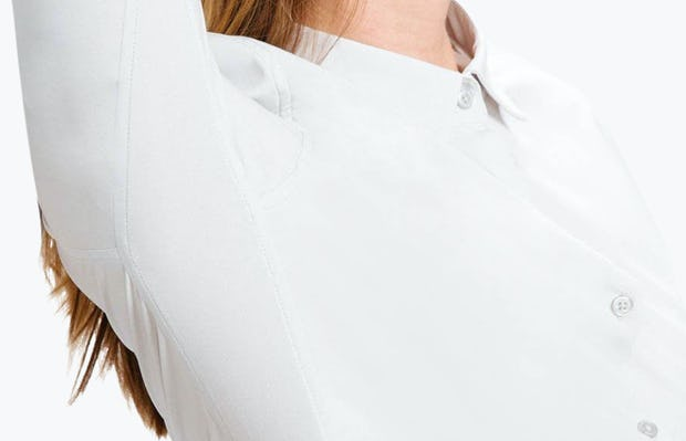 Women's Pale Grey Easier than Silk Shirt on Model in Close-Up of Arm Raised to Show Stretch