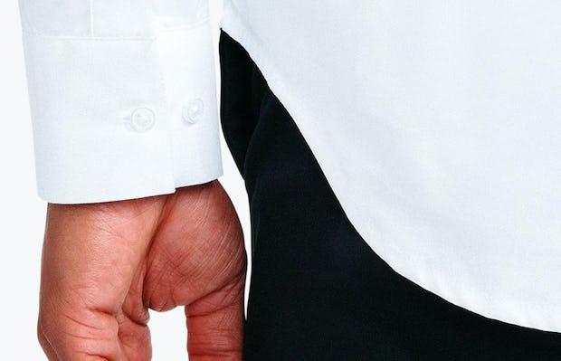 Men's White Nylon Aero Dress Shirt on Model Facing Backward in Close-Up of Buttoned Sleeve Cuffs