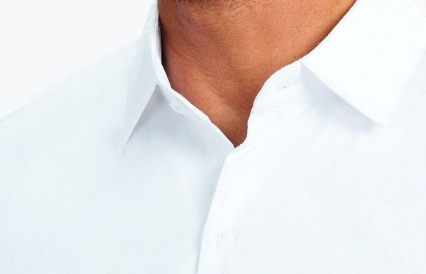 Men's White Nylon Aero Dress Shirt on Model Facing Forward in Close-Up of Unbuttoned Collar