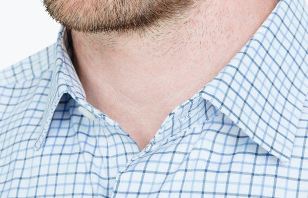 Men's Blue Tattersall Aero Dress Shirt on Model Facing Forward in Close-Up of Unbuttoned Collar