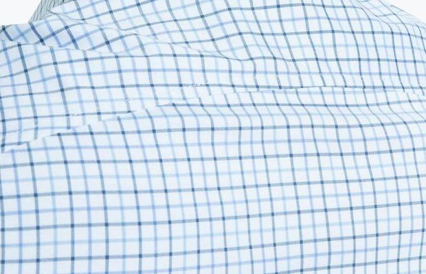 Men's Blue Tattersall Aero Dress Shirt on Model Facing Backward in Close-Up of Curved Back Yoke