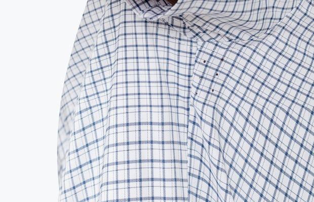 Men's Navy Plaid Aero Short Sleeve Dress Shirt on Model in Close-Up Underarm Ventilation