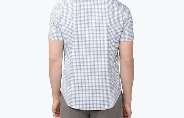 Men's Navy Plaid Aero Short Sleeve Dress Shirt on Model Facing Backwards