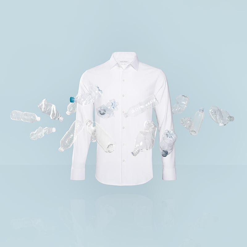 Apollo dress shirt in white on blue background with water bottles surrounding it