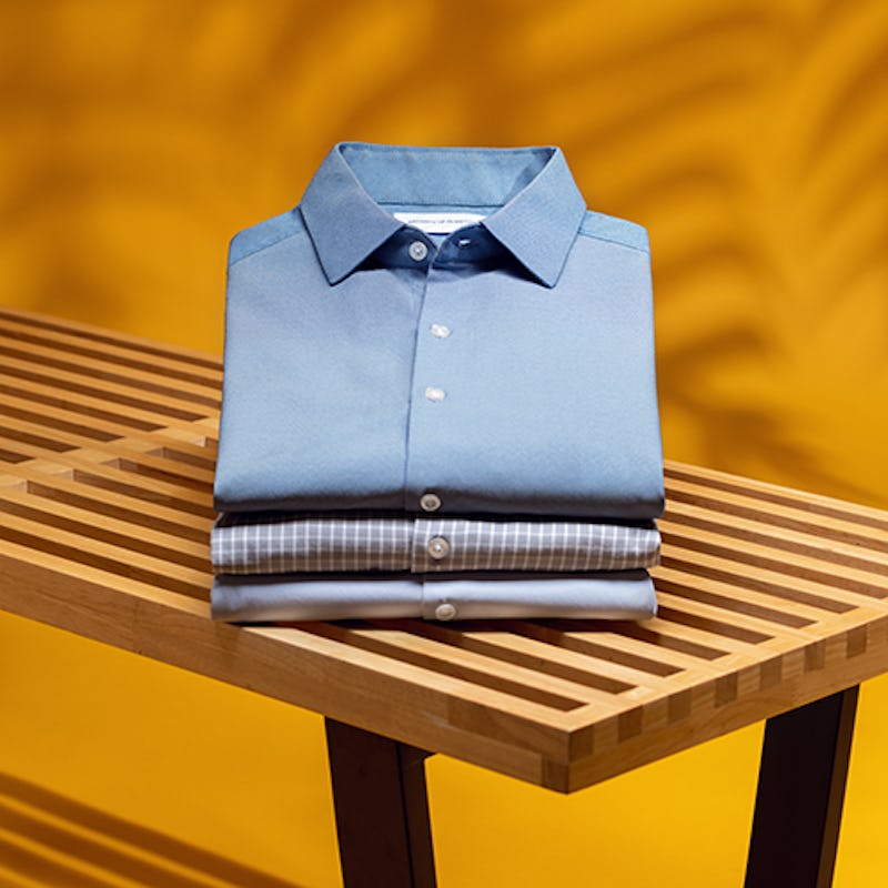 Stack of men's dress shirts on a bench