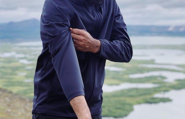 Man Wearing Men's Navy Doppler Packable Jacket Adjusting Sleeve