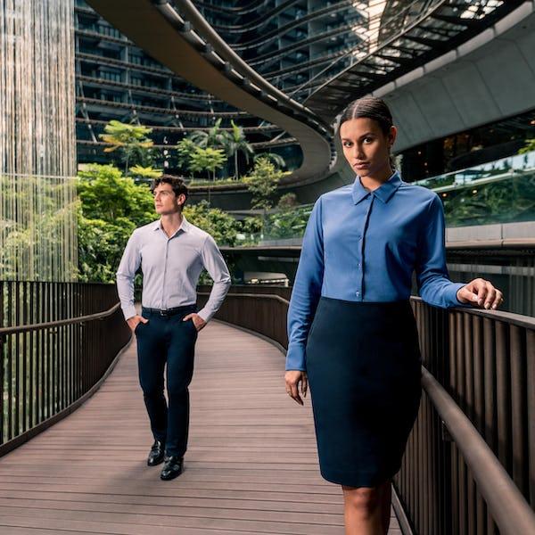 Man and woman wearing Apollo Dress Shirts Walking Outdoors