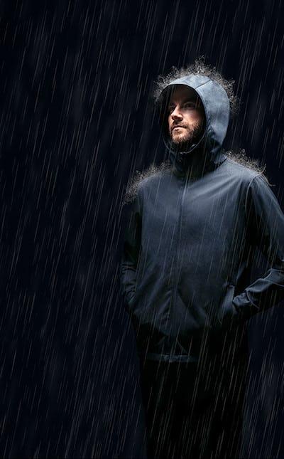 Man standing in rain wearing Doppler Jacket