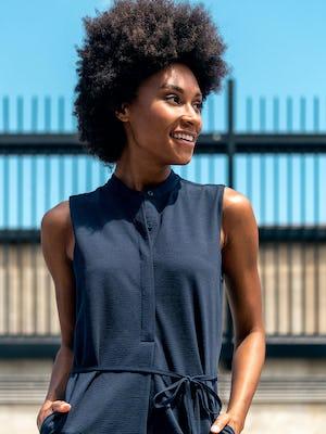 Women's Hybrid Seersucker Dress Navy close shot of model outdoors with hands in pockets