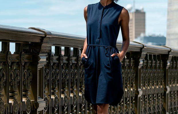 Women's Hybrid Seersucker Dress Navy model outdoors with hands in pockets walking on bridge