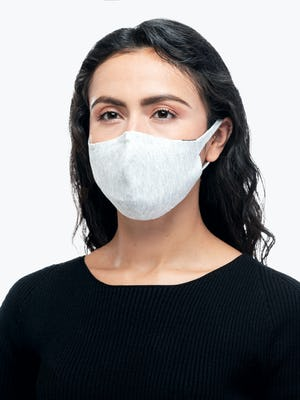 model wearing light grey 3d print knit mask 2.0 facing forward