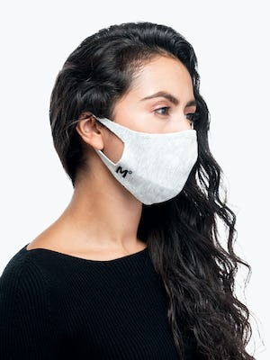 model wearing light grey 3d print knit mask 2.0 facing to the side