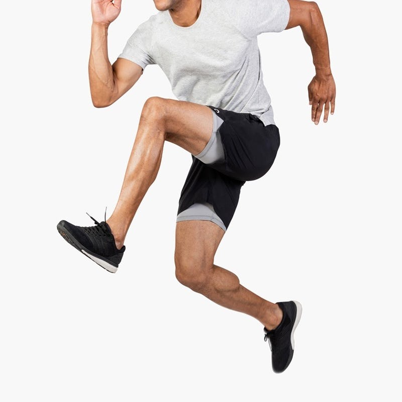 Man Wearing Newton Active Shorts and Composite Merino Active Tee Leaping in Air