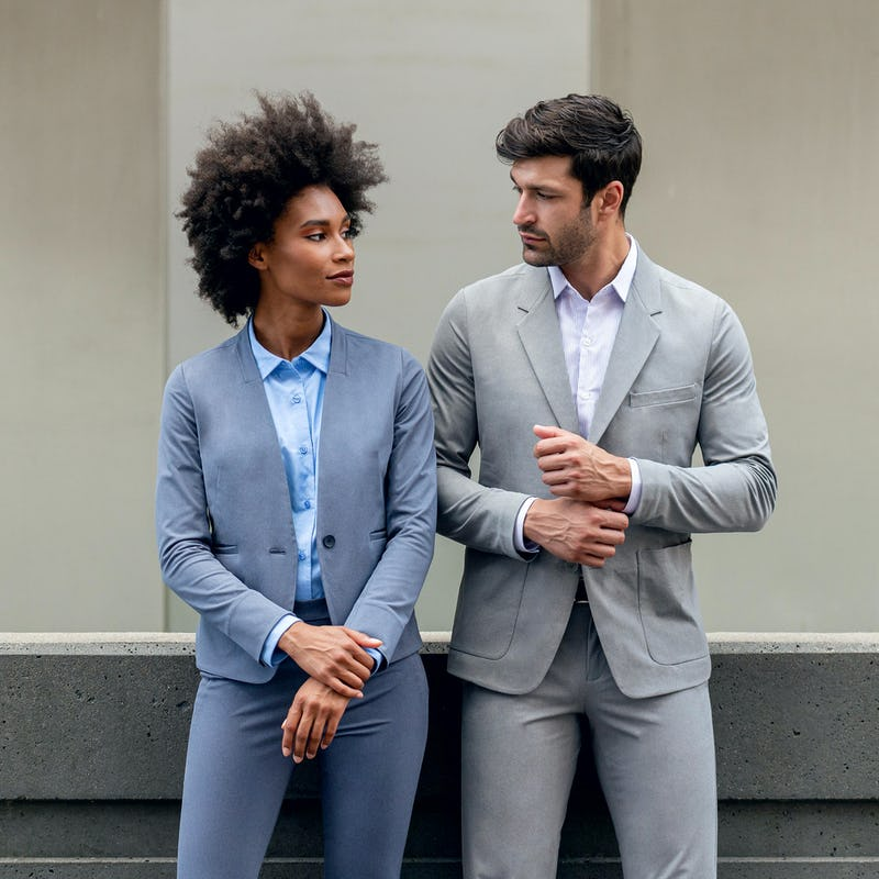 Man and Woman wearing Kinetic Suits looking at Each Other
