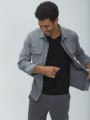 men's flint grey fusion overshirt unbuttoned model looking down holding shirt open