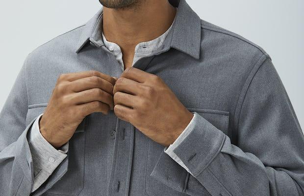 men's flint grey fusion overshirt model looking forward buttoning shirt