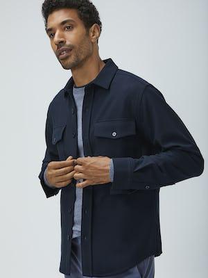 men's navy fusion overshirt unbuttoned model holding shirt closed