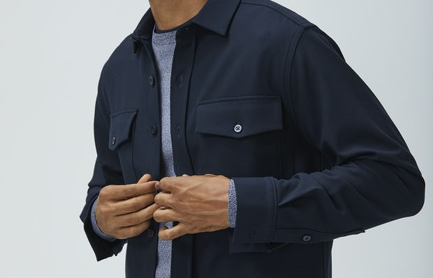 men's navy fusion overshirt unbuttoned model holding shirt closed