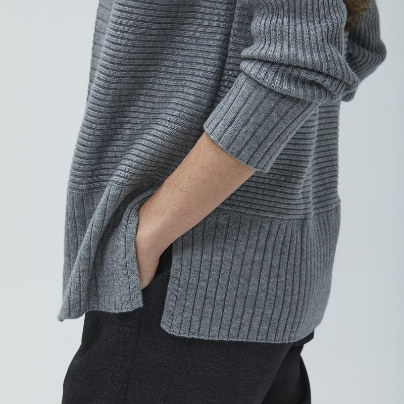 Woman with hand in pocket wearing grey composite cardigan