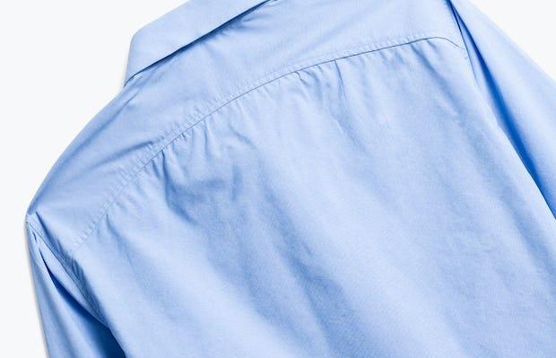 close up of men's solid blue nylon aero dress shirt shot of back