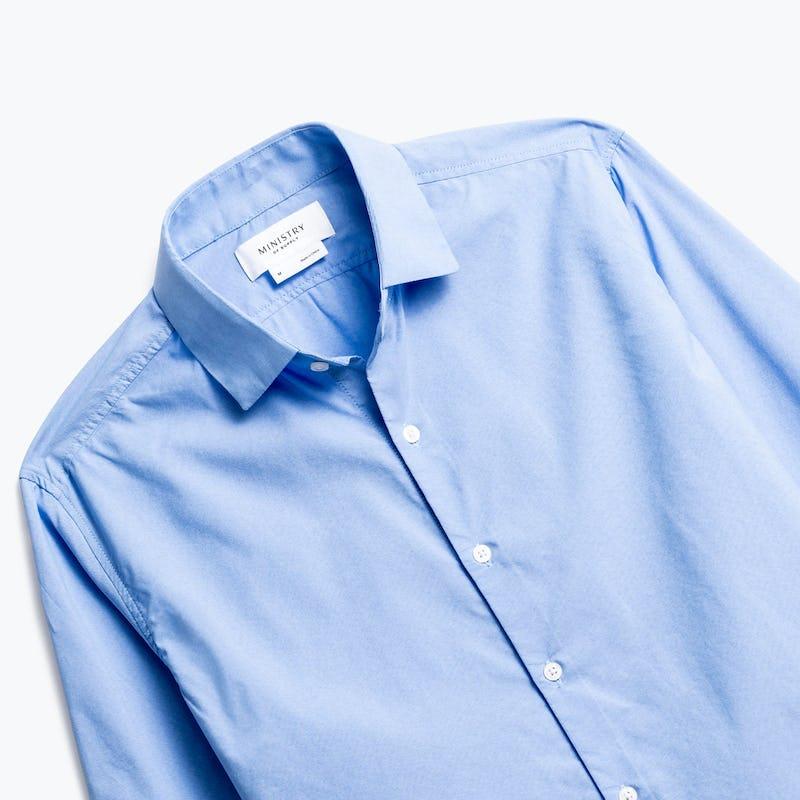close up of men's solid blue nylon aero dress shirt shot of front