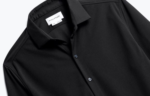 close up of men's black apollo dress shirt shot of front