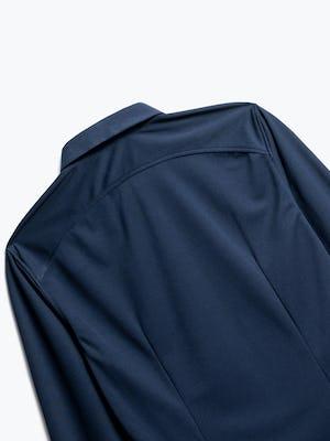 close up of men's navy apollo dress shirt shot of back
