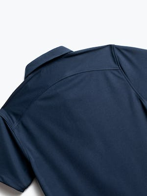 close up of men's navy apollo polo shot of back