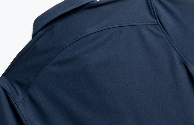 close up of men's navy apollo polo shot of back