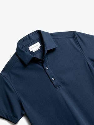 close up of men's navy apollo polo shot of front
