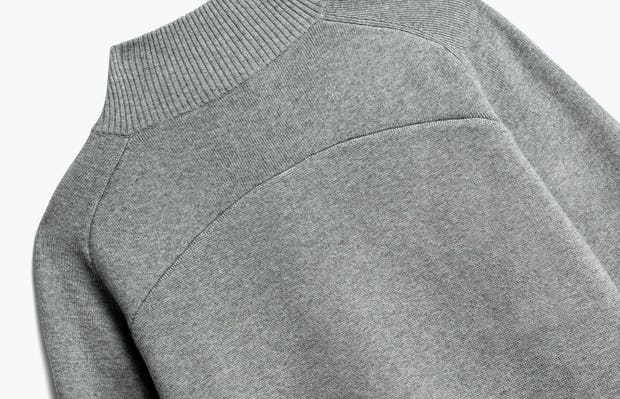close up of men's light grey atlas merino button collar shot of back